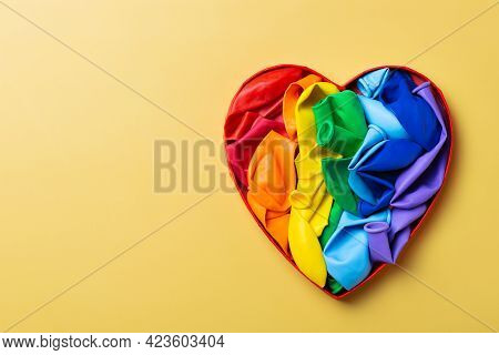 Heart Shaped Rainbow Lgbtq Flag Against Yellow Background, Pride Month