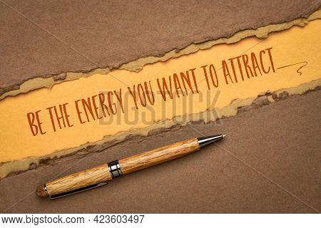 be the energy you want to attract - inspirational handwriting on a handmade paper, law of attraction and personal development concept