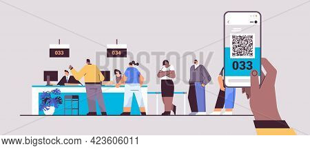 Mix Race People Looking At Display Number Board In Waiting Room Electronic Queuing System Queue Mana