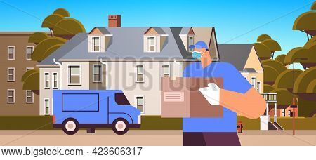 Male Courier In Mask And Gloves Holding Cardboard Box Contactless Delivery Medical Courier Service C