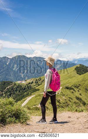 rear view of Asian climbing woman look far away at Hehuan mountain, Taiwan