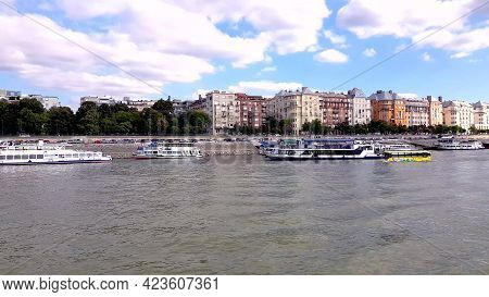 Comfortable Yellow Bus Tour Floating On River Danube. Amphibian Bus Floating On The River Towards Th