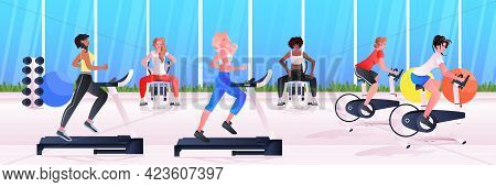 Sports Women Group Doing Physical Exercises Mix Race Girls Training In Gym Aerobic Workout Healthy L