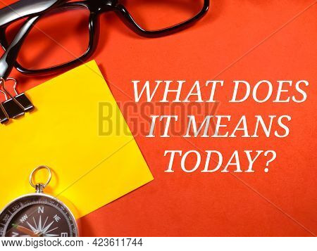 Education Concept.text What Does It Means Today? With Compass And Glasses On Red Background.