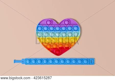New Fashionable Colorful Silicone Toy-antistress Pop It In The Shape Of A Rainbow Heart And A Blue S