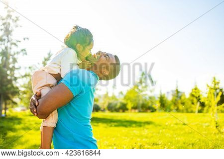 Fathers Day Celebration Happy Afro American Man With His Cute Baby In Summer Park Having Fun Togethe