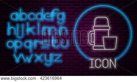 Glowing Neon Line Thermos Container And Cup Icon Isolated On Brick Wall Background. Thermo Flask Ico