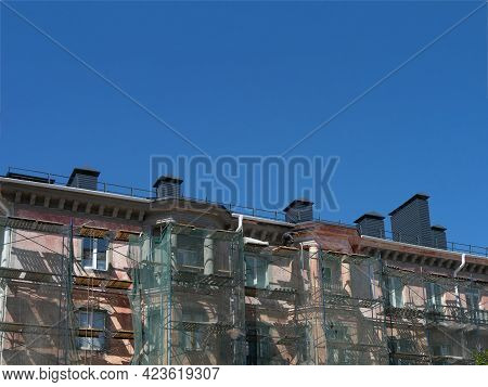 Scaffolding Around A Building, Renovating Facade Building