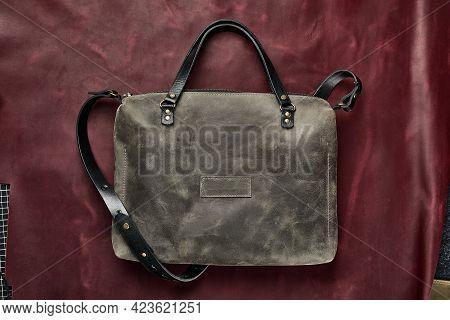 Stylish Gray Bag, Leather Haberdashery On A Burgundy Piece Of Leather. Fashion, Style, Handmade Leat