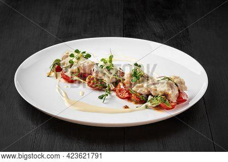 Cod Fillet With Tomato Saute And Alfredo Cream Cheese Sauce