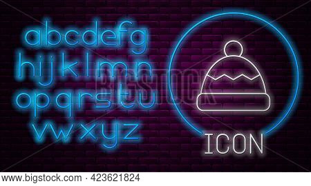 Glowing Neon Line Beanie Hat Icon Isolated On Brick Wall Background. Neon Light Alphabet. Vector