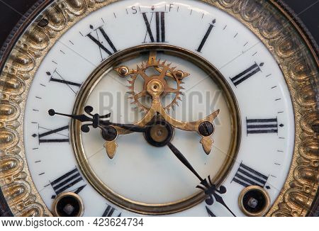 The Dial Of An Old Clock In The Room