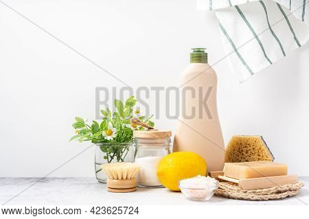 Eco Friendly Natural Cleaners, Jar With Baking Soda, Dish Brush, Lemon, Flowers, Soap On White Backg