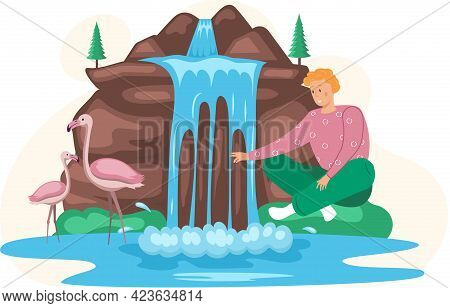 Man Sits Next To Rock And Waterfall Enjoys Wonderful Natural Place With Clean Nature, Tropical River