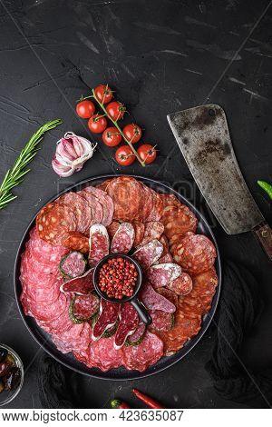 Spanish Cold Meat Plate, Chorizo, Fuet, Lomo,longaniza And Salchichon  On Balck Background, Top View