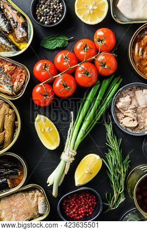 Mix Of Canned Preserves  Food In Cans With Fresh Organic Bio Ingredients Tomatoe Herbs Lemon On The