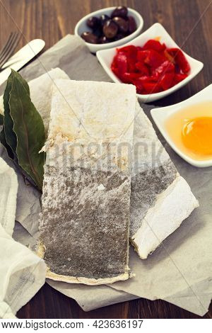 Cod Fish With Potato On Wooden Background