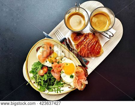 Classic rich breakfast with salmon eggs and French croissants