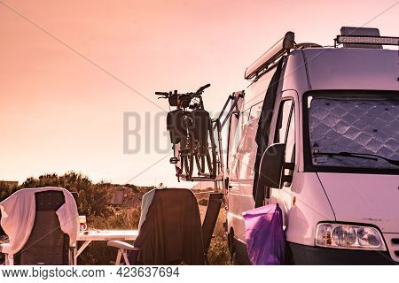Camper Van With Bicycles On Rack Camping On Spanish Coast. Bikes Carrier At The Rear Of Car. Summer