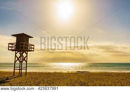 Quitapellejos Beach, Andalucia Region In Spain. Coastal Landscape Sandy Seashore With Lifeguard Towe