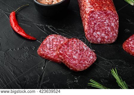 Salami, Salami Smoked Sausage, Sliced Set, On Black Dark Stone Table Background, With Copy Space For