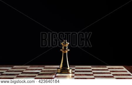 Golden Queen Chess Figure Standing On Chessboard. Intellectual And Tactic Game. Strategy Planning, L