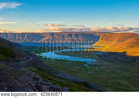 Icelandic Landscape With Fjord And Gravel Road At Sunset In Westfjords, Iceland