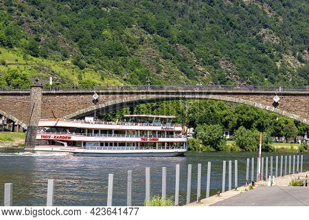 Cochem, Germany, June 13, 2021. People Walk On The Bridge And A Tourist Boat Passes Underneath It In