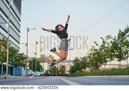 Young Woman Jumping For Joy In The City