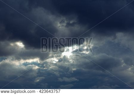 Dark Clouds Before Rain . Dramatic Stormy Sky Light Beam . Meteorology Background