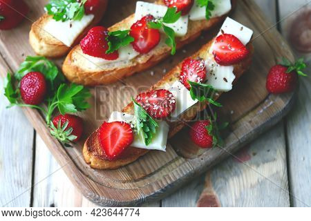 Beautiful Strawberry Toast With White Cheese. Strawberry Bruschetta. A Healthy Summer Snack.