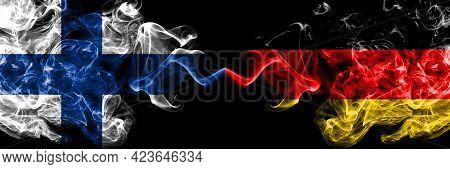 Finland, Finnish Vs Germany, German, Deutschland Smoky Flags Side By Side.