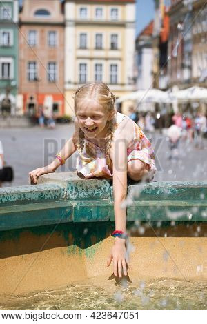 Girls Playing At The Fountain On A Poznan Main Square
