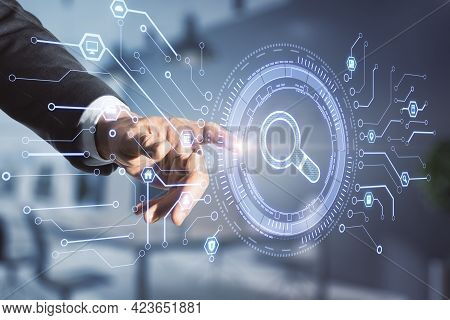 Search And Find Concept With Businessman Hand On Digital Touch Screen With Loupe Icon In A Microcirc