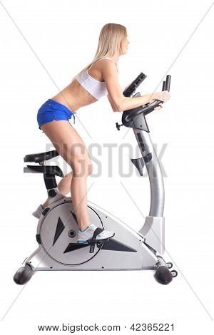 Athletic blonde training on bike exerciser