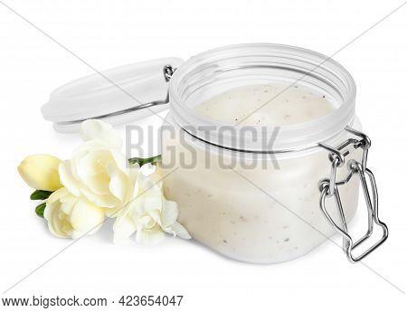 Jar Of Exfoliating Salt Scrub And Freesia Flowers On White Background