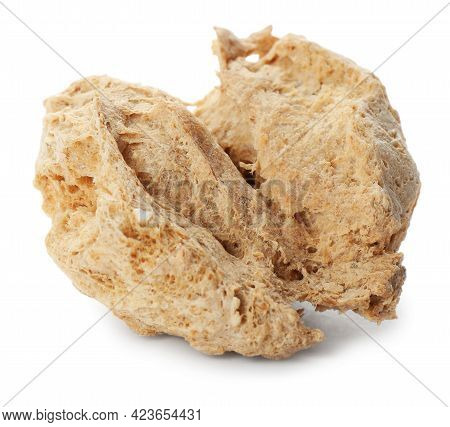 One Dehydrated Soy Meat Chunk Isolated On White