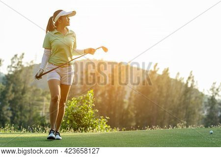 Golfer Sport Course Golf Ball Fairway. People Lifestyle Woman Relax After Swing Golf Ball On The Gre