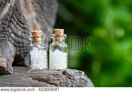 Two Bottles Of Homeopathy Globules. Bottles Of Homeopathic Granules. Homeopathy Medicine Concept.