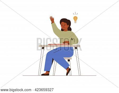 School Girl Sitting At A Desk In A Classroom And Has An Idea. African American Female Student At The