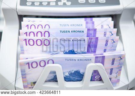 Norwegian Kroner Banknotes Inside Bank Branch Bill Counter. One Thousand Kroner Bills. Scandinavian
