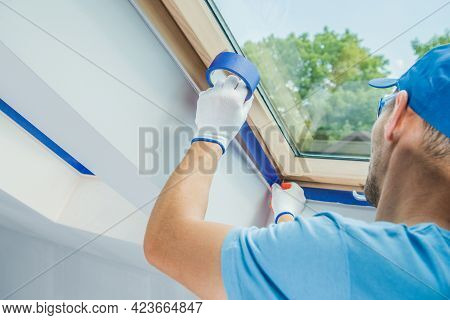 Caucasian Men Preparing Room Window Edges For Painting Job. House Interior Remodeling And Refreshing