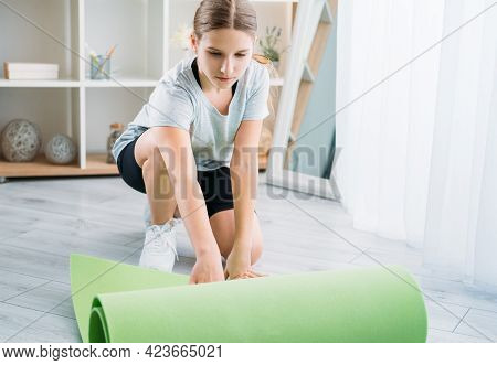 Active Kids. Home Pilates. Sport Leisure. Workout Indoors. Athletic Girl In Sportswear Unrolling Gre