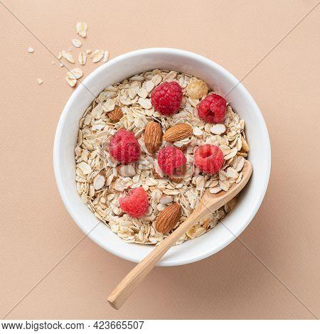 Dry Oat Muesli With Almonds And Fresh Raspberries