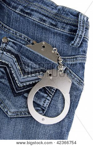 Handcuffs in the pocket of a blue jeans poster