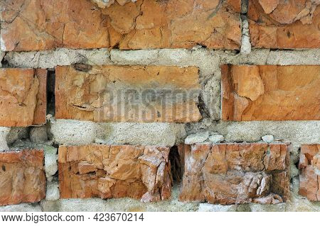 Red Old Brick Wall Background, Brick Wall Texture, Brick Wall Structure. Old Broken Brick, Cement Jo