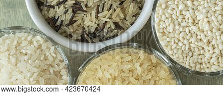 Banner With Close Up Different Types Of Rice. Wild Rice, Sushi Rice, Shredded And Steamed Rice On A