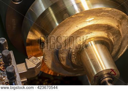 The Operation Of Lathe Machine Cutting The Brass Shaft Material. The Metalworking Process By Turning