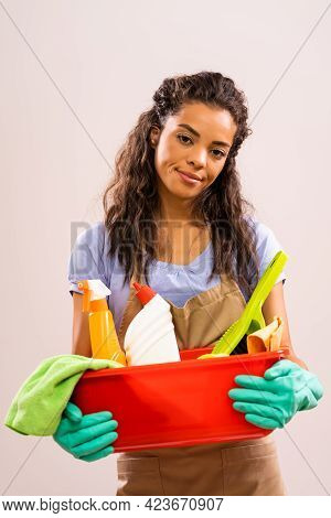 Portrait Of African-american Professional Maid Who Is Tired Of Cleaning.