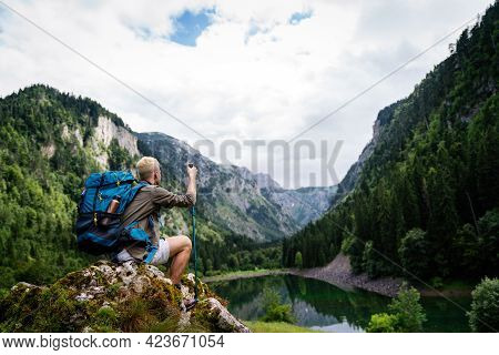 Active Healthy Man Hiking In Beautiful Nature. Outdoor Activity, Sport Conecpt